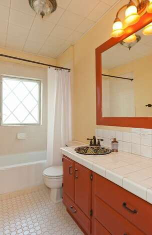 Bathroom of 1515 1st Ave. N. The 2,644-square-foot house, built in 1907, has four bedrooms, 1.75 bathrooms, a formal entry, inlaid hardwood floors, pocket doors, a gas fireplace, a front porch and a back deck over a two-car garage on a 6,000-square-foot lot. It's listed for $850,000. Photo: Courtesy Randie Nelson/Windermere Real Estate