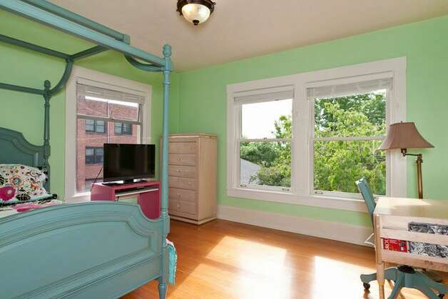 Bedroom of 1515 1st Ave. N. The 2,644-square-foot house, built in 1907, has four bedrooms, 1.75 bathrooms, a formal entry, inlaid hardwood floors, pocket doors, a gas fireplace, a front porch and a back deck over a two-car garage on a 6,000-square-foot lot. It's listed for $850,000. Photo: Courtesy Randie Nelson/Windermere Real Estate