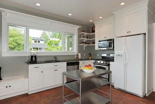 Kitchen of 1515 1st Ave. N. The 2,644-square-foot house, built in 1907, has four bedrooms, 1.75 bathrooms, a formal entry, inlaid hardwood floors, pocket doors, a gas fireplace, a front porch and a back deck over a two-car garage on a 6,000-square-foot lot. It's listed for $850,000. Photo: Courtesy Randie Nelson/Windermere Real Estate
