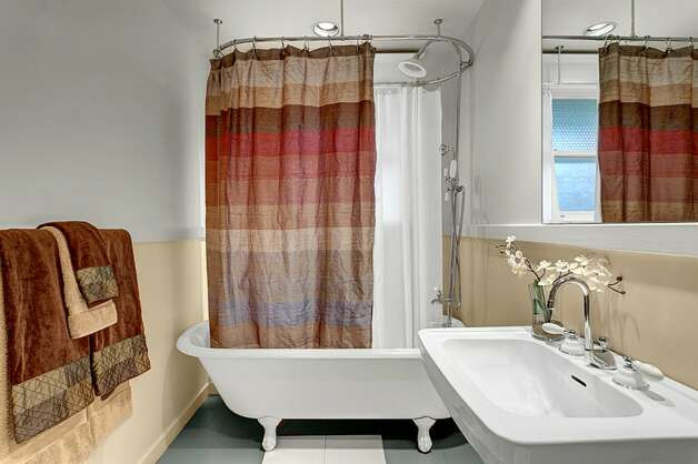 Bathroom of 2316 Nob Hill Ave. N. The 2,400-square-foot house, built in 1914, has four bedrooms, 1.75 bathrooms, ribboned oak floors, box beam ceilings, built-in cabinets with leaded glass, wainscoting, a front porch, a back patio and a Chinese granite water feature on a 3,840-square-foot lot. It's listed for $824,900. Photo: Courtesy Ron Waxman And Ricklie Stone/Coldwell Banker Bain