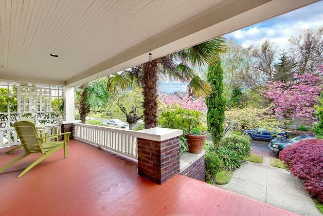 Front porch of 2316 Nob Hill Ave. N. The 2,400-square-foot house, built in 1914, has four bedrooms, 1.75 bathrooms, ribboned oak floors, box beam ceilings, built-in cabinets with leaded glass, wainscoting, a back patio and a Chinese granite water feature on a 3,840-square-foot lot. It's listed for $824,900. Photo: Courtesy Ron Waxman And Ricklie Stone/Coldwell Banker Bain