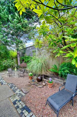 Back yard, with patio and Chinese granite water feature, of 2316 Nob Hill Ave. N. The 2,400-square-foot house, built in 1914, has four bedrooms, 1.75 bathrooms, ribboned oak floors, box beam ceilings, built-in cabinets with leaded glass, wainscoting and a front porch on a 3,840-square-foot lot. It's listed for $824,900. Photo: Courtesy Ron Waxman And Ricklie Stone/Coldwell Banker Bain