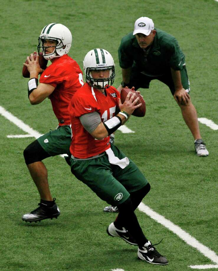 Jets starting quarterback Mark Sanchez (left) and his backup, Tim Tebow, take part in practice Tuesday. Photo: AP