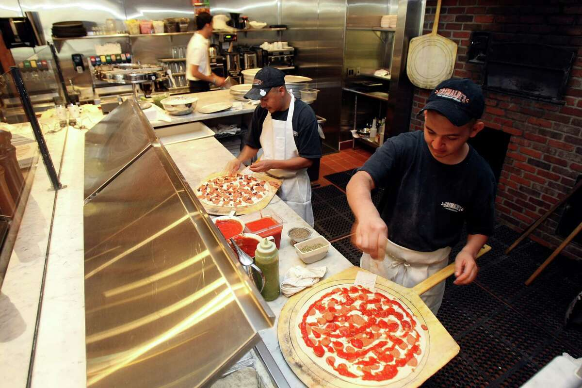 Pizzas are prepared before going into the coal-burning oven at Grimaldi's.