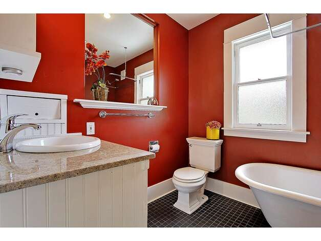 Bathroom of 2402 Westview Drive W. The 2,680-square-foot house, built in 1908, has four bedrooms, 2.25 bathrooms, a glazed tile fireplace, a den, a media room and period fixtures on a 3,256-square-foot lot. It's listed for $819,000. Photo: Courtesy Carolyn Holm/Windermere Real Estate