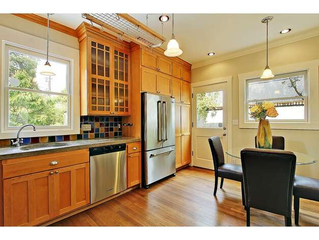 Kitchen of 2402 Westview Drive W. The 2,680-square-foot house, built in 1908, has four bedrooms, 2.25 bathrooms, a glazed tile fireplace, a den, a media room and period fixtures on a 3,256-square-foot lot. It's listed for $819,000. Photo: Courtesy Carolyn Holm/Windermere Real Estate