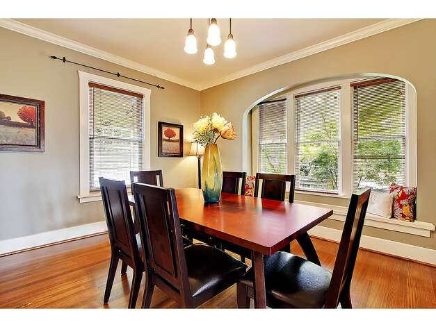 Dining room of 2402 Westview Drive W. The 2,680-square-foot house, built in 1908, has four bedrooms, 2.25 bathrooms, a glazed tile fireplace, a den, a media room and period fixtures on a 3,256-square-foot lot. It's listed for $819,000. Photo: Courtesy Carolyn Holm/Windermere Real Estate