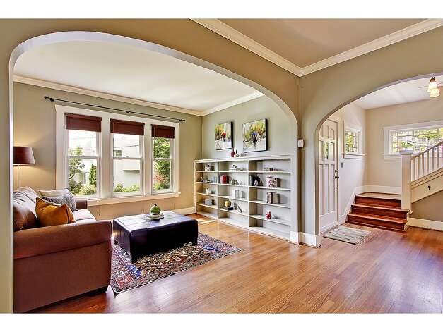 Den of 2402 Westview Drive W. The 2,680-square-foot house, built in 1908, has four bedrooms, 2.25 bathrooms, a glazed tile fireplace, a den, a media room and period fixtures on a 3,256-square-foot lot. It's listed for $819,000. Photo: Courtesy Carolyn Holm/Windermere Real Estate