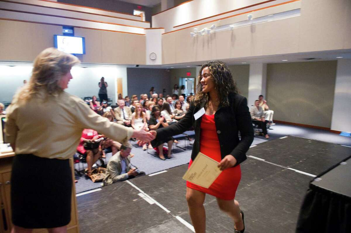 AITE student Fernanda Reyes is greeted by Jeannine Egdorf, vice president of Stamford Dollars for Scholars, as the program hosts its first ceremony for scholarship recipients at UConn Stamford in Stamford, Conn., June 11, 2012.