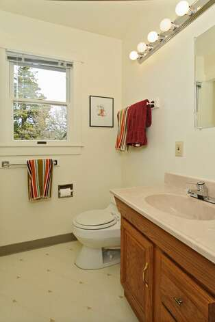 Bathroom of 2212 2nd Ave. W. The 2,840-square-foot house, built in 1905, has four bedrooms, 3.5 bathrooms, a formal entry, a family room, a large kitchen with an island and eating area, front and back patios, and side and back decks on a 5,400-square-foot lot. It's listed for $849,500, although a sale is pending. Photo: Courtesy Rene Stern/Windermere Real Estate
