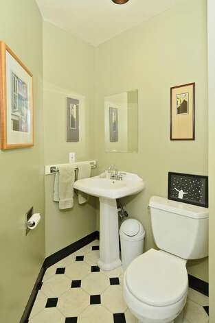 Powder room of 2212 2nd Ave. W. The 2,840-square-foot house, built in 1905, has four bedrooms, 3.5 bathrooms, a formal entry, a family room, a large kitchen with an island and eating area, front and back patios, and side and back decks on a 5,400-square-foot lot. It's listed for $849,500, although a sale is pending. Photo: Courtesy Rene Stern/Windermere Real Estate