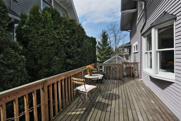 Side deck of 2212 2nd Ave. W. The 2,840-square-foot house, built in 1905, has four bedrooms, 3.5 bathrooms, a formal entry, a family room, a large kitchen with an island and eating area, front and back patios, and side and back decks on a 5,400-square-foot lot. It's listed for $849,500, although a sale is pending. Photo: Courtesy Rene Stern/Windermere Real Estate
