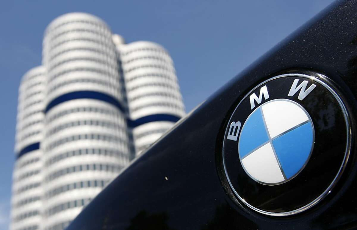 FILE - In this July 29, 2009 file picture the logo of the German car producer BMW AG is photographed on the back of a car in front of the company's headquarter in Munich, southern Germany. BMW AG saw sales rise 6.4 percent in May from a year ago, as big increases in Asia and better numbers in United States overcame a dip in struggling Europe. (AP Photo/Matthias Schrader,File)