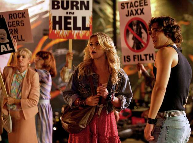 "JULIANNE HOUGH as Sherrie Christian and DIEGO BONETA as Drew Boley in ""Rock of Ages"" Photo: David James, Warner Bros. Pictures / © 2012 Warner Bros. Entertainment Inc.  All Rights Reserved."