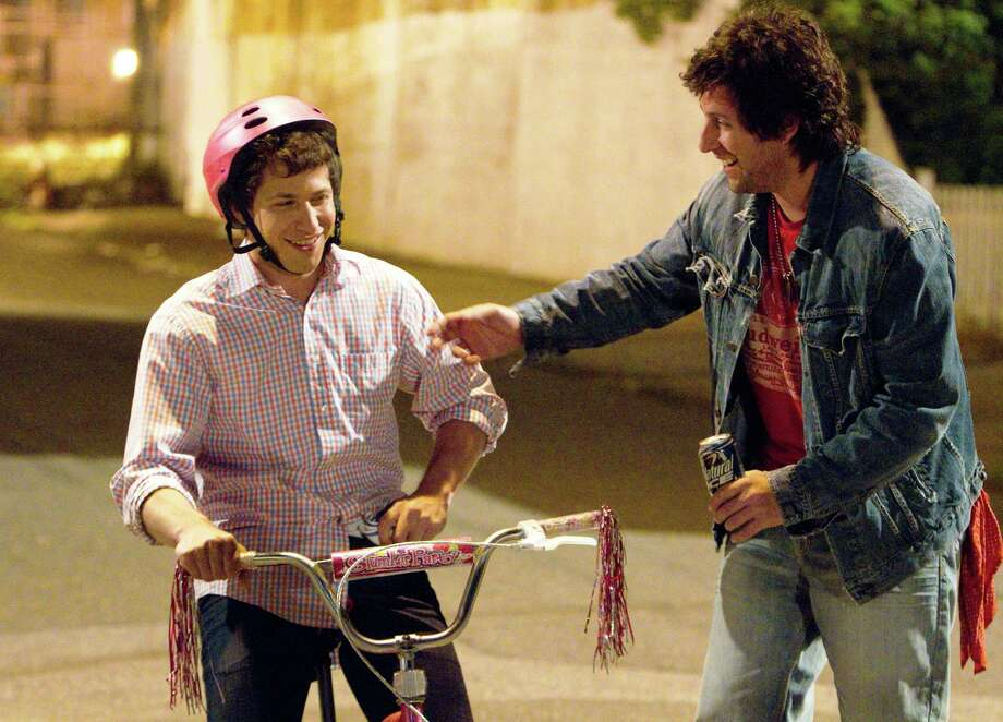 "Donny Berger (Adam Sandler) tries to make up for lost time by teaching his grown son, Todd Peterson (Andy Samberg), to ride a bike in ""That's My Boy."" Photo: Tracy Bennett, Columbia Pictures / © 2011 Columbia TriStar Marketing Group, Inc.  All Rights Reserved. **ALL IMAGES ARE PROPERTY OF SONY PICTURES ENTERTAINMENT INC. FOR PROMOTIONAL USE ONLY.  SALE, DUPLICATION OR TRANSFER OF THIS MATERIAL IS STRICTLY PROHIBITED."