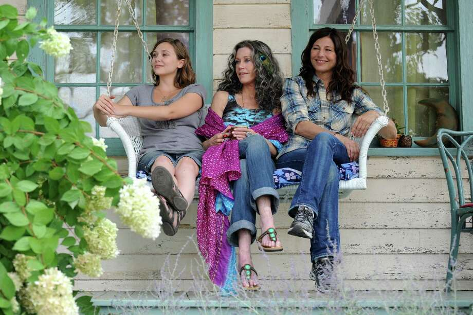 "This image released by IFC Films shows Elizabeth Olsen, left, Jane Fonda and Catherine Keener in a scene from ""Peace Love and Misunderstanding."" Photo: AP"
