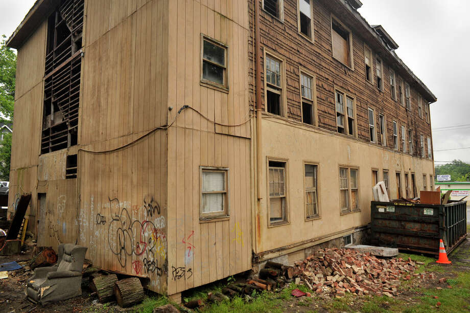 Steve Palmiotto recently bought the former apartment building at 408 Main Street in Danbury and is renovating it with the hopes of having the exterior completed by the end of this summer. Photographed on Tuesday, June 12, 2012. Photo: Jason Rearick / The News-Times