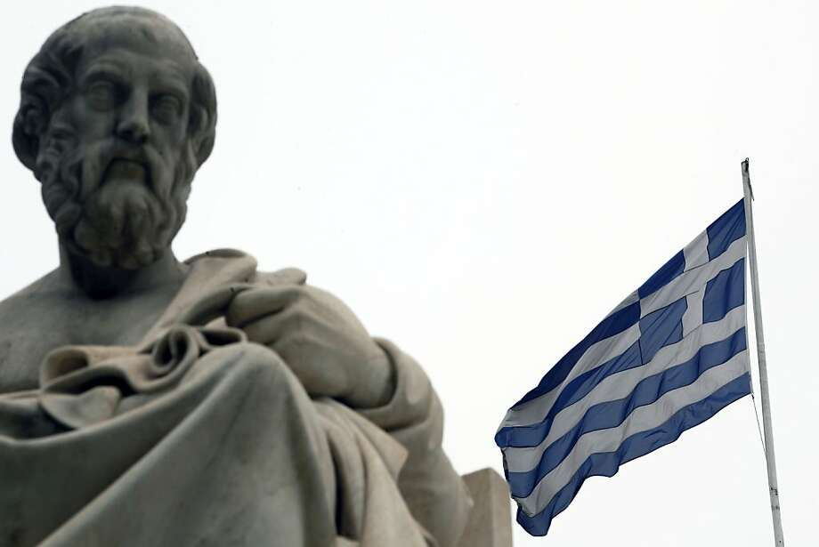 A Greek national flag flies from the roof of Athens University, near a sculpture of the Greek philosopher Plato, in Athens, Greece, on Monday. May 21, 2012. Syriza's opposition to the terms of Greece's financial-aid program doesn't mean the country would have to abandon the euro if the party forms a government after June 17 elections, party leader Alexis Tsipras said. Photographer: Angelos Tzortzinis/Bloomberg Photo: Angelos Tzortzinis, Bloomberg