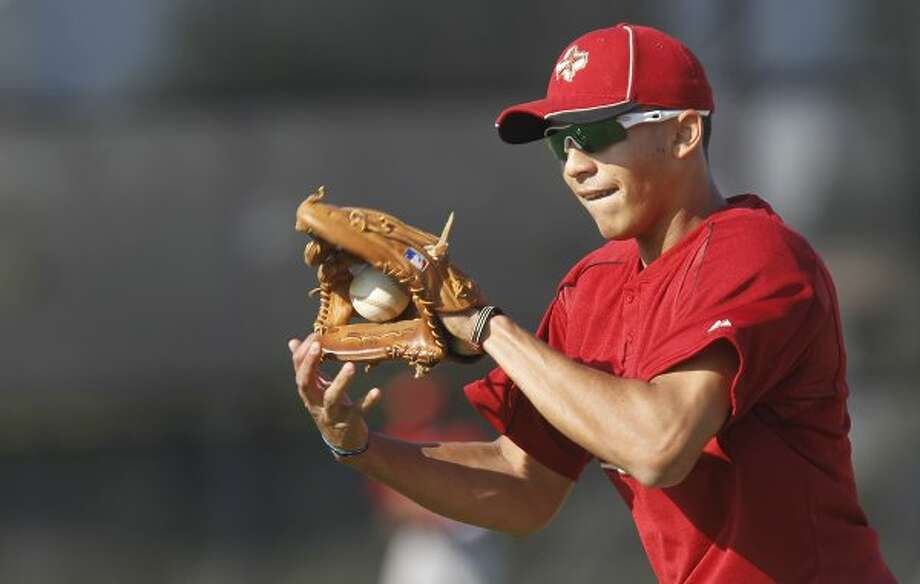 Carlos Correa's first workout included some fielding work and batting practice. (Mayra Beltran / Houston Chronicle)