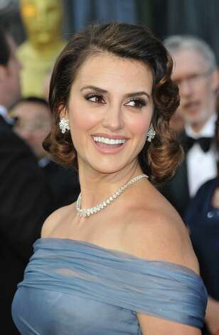 Actress Penelope Cruz arrives on the red carpet for the 84th Annual Academy Awards on February 26, 2012 in Hollywood, California. AFP PHOTO Joe KLAMAR Photo: JOE KLAMAR, AFP/Getty Images / 2012 AFP