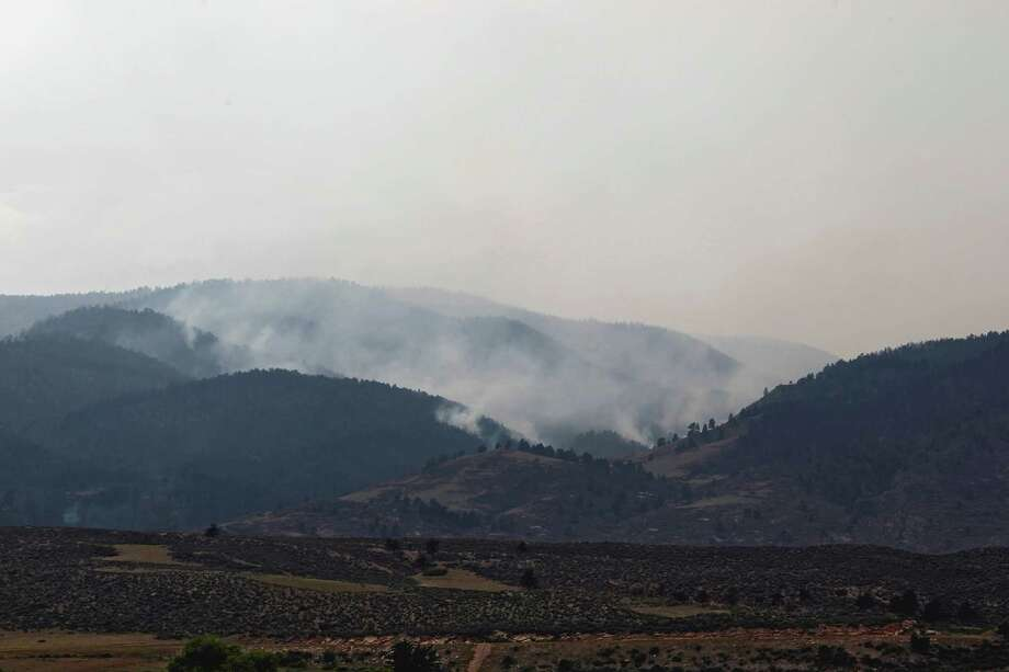 Smoke rises from the High Park wildfire west of Fort Collins, Colo., on Tuesday. Photo: Ed Andrieski / AP
