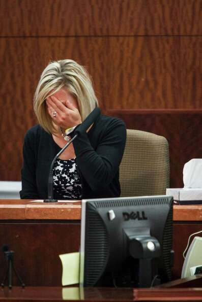 Mindy Danaher reacts as she testifies on the stand during a trial against Raul Rodriguez who killed