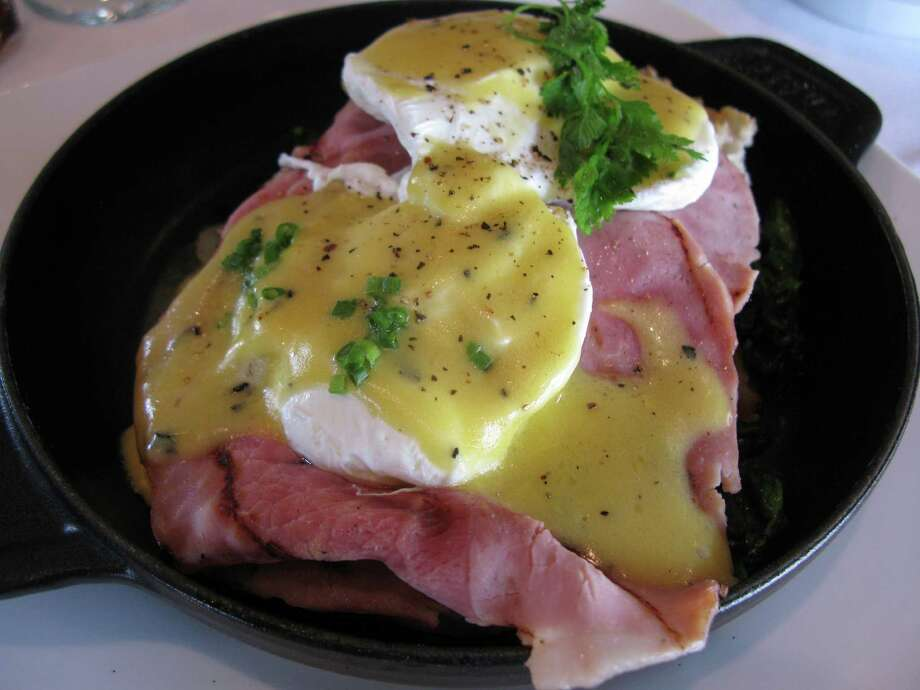 Our Famous Eggs Benedict at Laurent's Modern Cuisine. The dish is made with Black Forest ham and sauteed young spinach, Salardaises potatoes and truffle hollandaise. Photo: JENNIFER MCINNIS, SAN ANTONIO EXPRESS-NEWS / JMCINNIS@EXPRESS-NEWS.NET