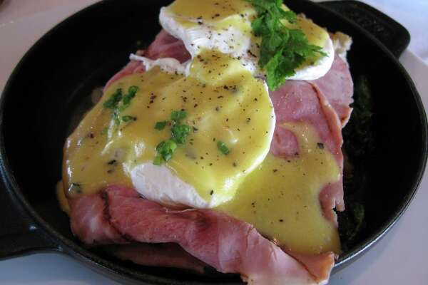 Our Famous Eggs Benedict at Laurent's Modern Cuisine. The dish is made with Black Forest ham and sauteed young spinach, Salardaises potatoes and truffle hollandaise.