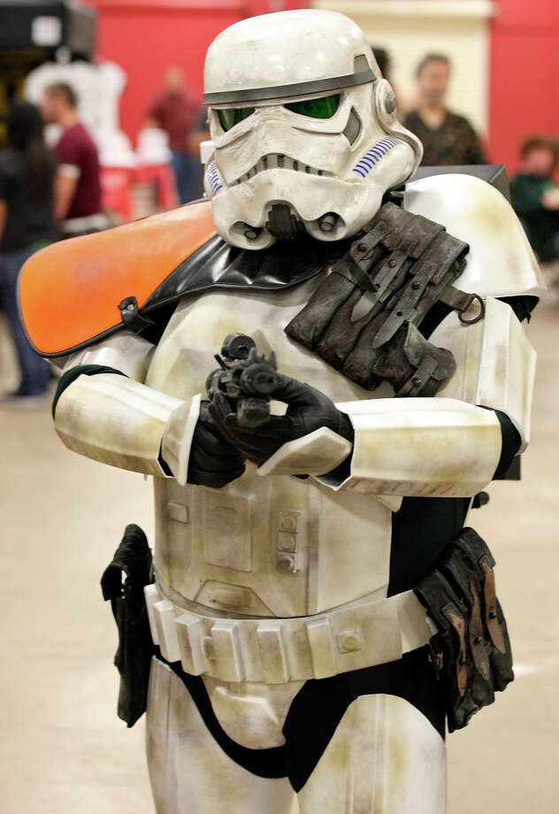 FOR METRO - John Laurel, 40, as a Sandtrooper, poses for a photo during the Texas Comicon 2011 Sunday June 26, 2011 at the San Antonio Event Center. (PHOTO BY EDWARD A. ORNELAS/eaornelas@express-news.net) Photo: EDWARD A. ORNELAS, SAN ANTONIO EXPRESS-NEWS / © SAN ANTONIO EXPRESS-NEWS (NFS)