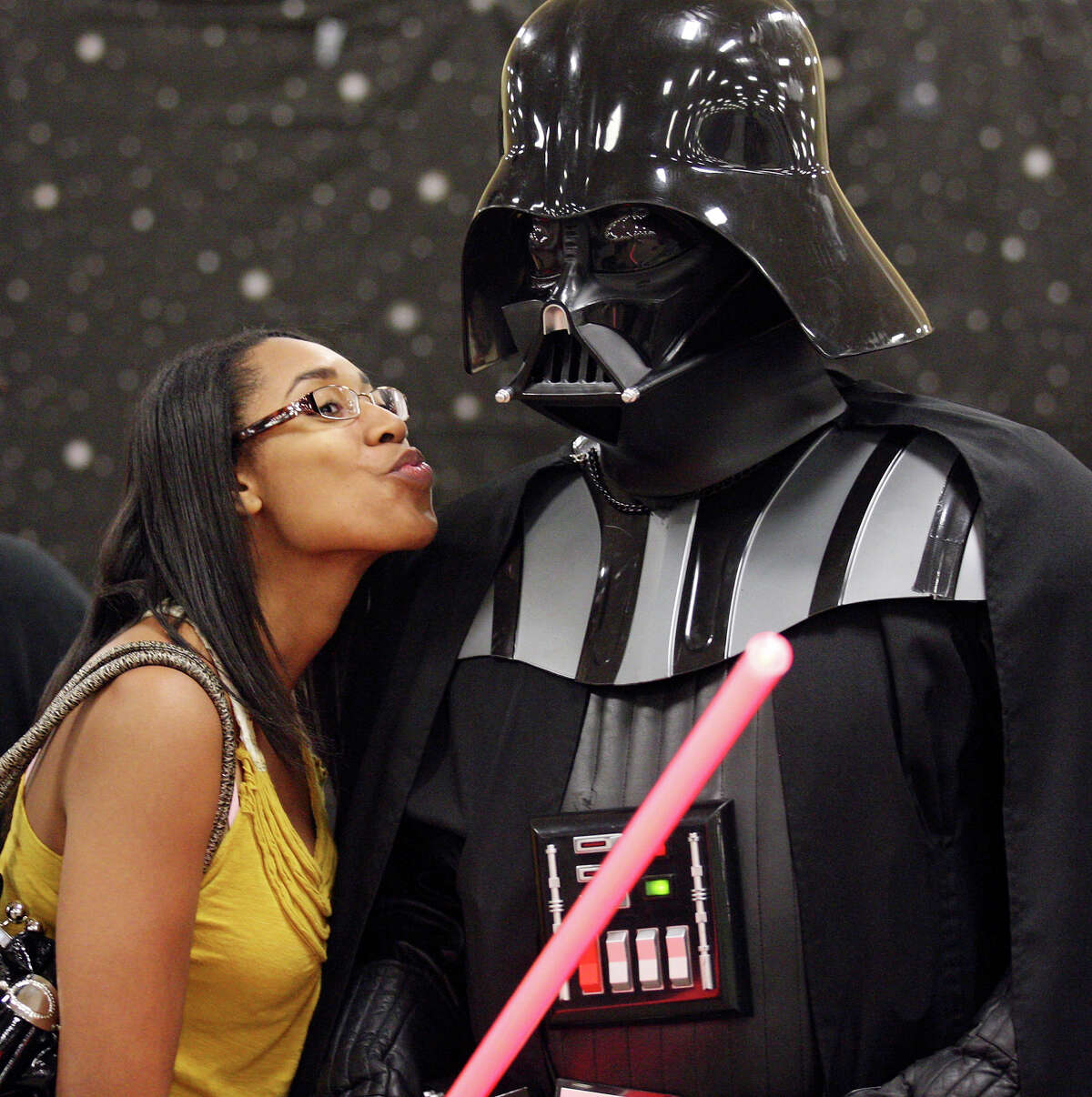 FOR METRO - Deshanta Smith, 23, poses for a photo with Victor Settles, 39, as Darth Vader during the Texas Comicon 2011 Sunday June 26, 2011 at the San Antonio Event Center. (PHOTO BY EDWARD A. ORNELAS/eaornelas@express-news.net)