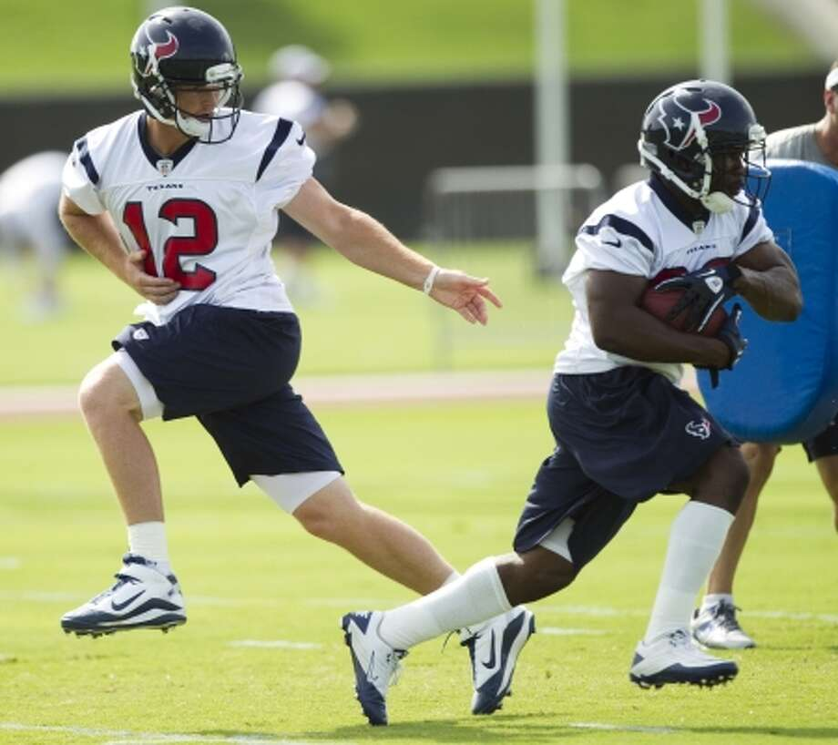 Tuesday, June 12Houston Texans quarterback John Beck (12) hands the ball off to running back Justin Forsett during Texans minicamp. (Brett Coomer / Houston Chronicle)