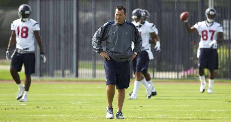 Houston Texans head coach Gary Kubiak surveys the field as the Texans crank up minicamp. (Brett Coomer / Houston Chronicle)