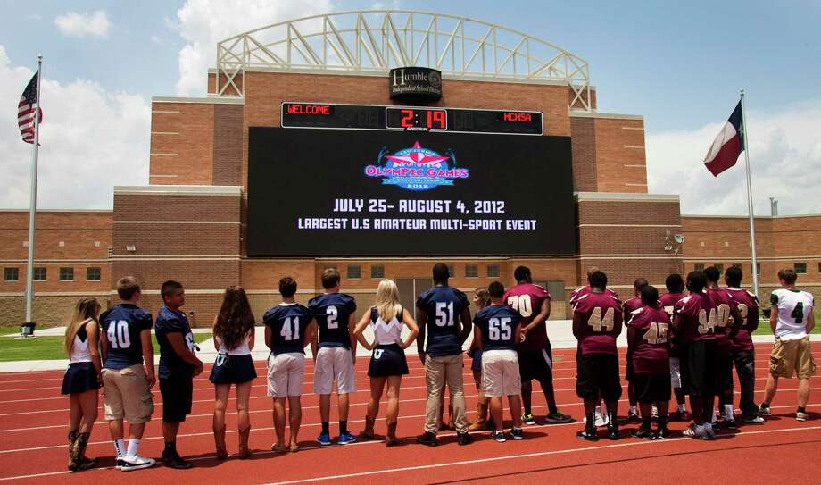 Humble-area students and athletes watch a presentation on Turner Stadium's new video board, which at 960 square feet is the nation's largest in a high school facility. Photo: J. Patric Schneider / Houston Chronicle