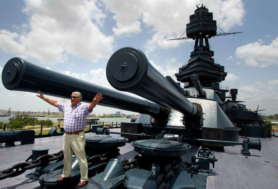 Juan Salinas poses for a snapshot Tuesday on the Battleship Texas, while workers toiled below to plug a serious hull breach. Photo: Cody Duty / © 2011 Houston Chronicle