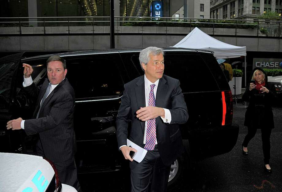 "Jamie Dimon, chief executive officer of JPMorgan Chase & Co., center, arrives at the Federal Reserve Bank of New York in New York, U.S., on Wednesday, May 2, 2012. Dimon said finance-industry leaders may discuss ""everything"" at a meeting with Federal Reserve officials in New York today. Photographer: Peter Foley/Bloomberg *** Local Caption *** Jamie Dimon Photo: Peter Foley, Bloomberg / © 2012 Bloomberg Finance LP"