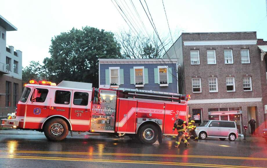 The Greenwich Fire Department responded to the scene of smoke in the building at 24 Bruce Park Ave., located at right, in Greenwich, Tuesday night, June 12, 2012. Photo: Bob Luckey / Greenwich Time