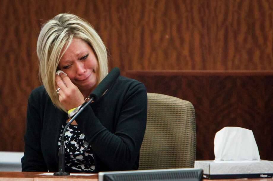 Mindy Danaher, fighting back tears while testifying Tuesday, was the final prosecution witness called to testify against Raul Rodriguez, who is on trial for murder in the 2010 shooting death of Danaher's husband, Kelly. Photo: Michael Paulsen / © 2012 Houston Chronicle