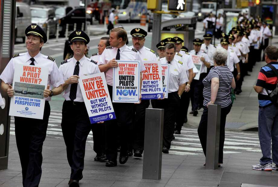 Members of the Air Line Pilots Association picket the United Airlines shareholders meeting in New York on Tuesday, part of an ongoing effort to secure better wages. Photo: Richard Drew / AP