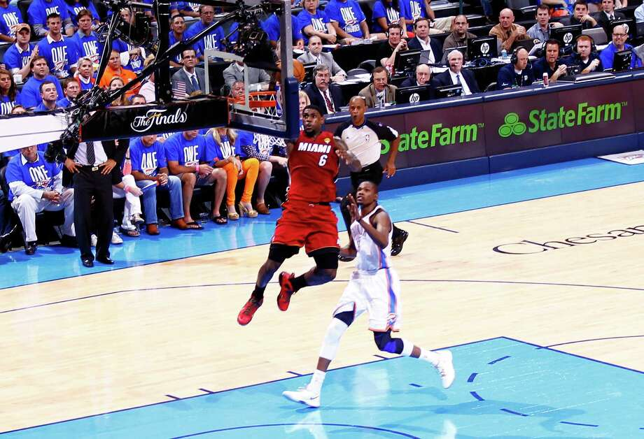 OKLAHOMA CITY, OK - JUNE 12:  LeBron James #6 of the Miami Heat goes up for a dunk in front of Kevin Durant #35 of the Oklahoma City Thunder in the first half in Game One of the 2012 NBA Finals at Chesapeake Energy Arena on June 12, 2012 in Oklahoma City, Oklahoma. NOTE TO USER: User expressly acknowledges and agrees that, by downloading and or using this photograph, User is consenting to the terms and conditions of the Getty Images License Agreement. Photo: Mike Ehrmann, Getty Images / 2012 Getty Images