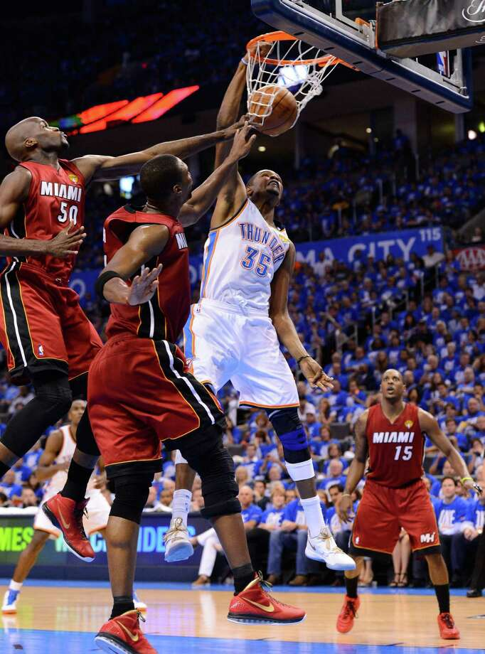 OKLAHOMA CITY, OK - JUNE 12:  Kevin Durant #35 of the Oklahoma City Thunder dunks the ball over Joel Anthony #50 and Chris Bosh #1 of the Miami Heat in the second quarter in Game One of the 2012 NBA Finals at Chesapeake Energy Arena on June 12, 2012 in Oklahoma City, Oklahoma. NOTE TO USER: User expressly acknowledges and agrees that, by downloading and or using this photograph, User is consenting to the terms and conditions of the Getty Images License Agreement. Photo: Ronald Martinez, Getty Images / 2012 Getty Images
