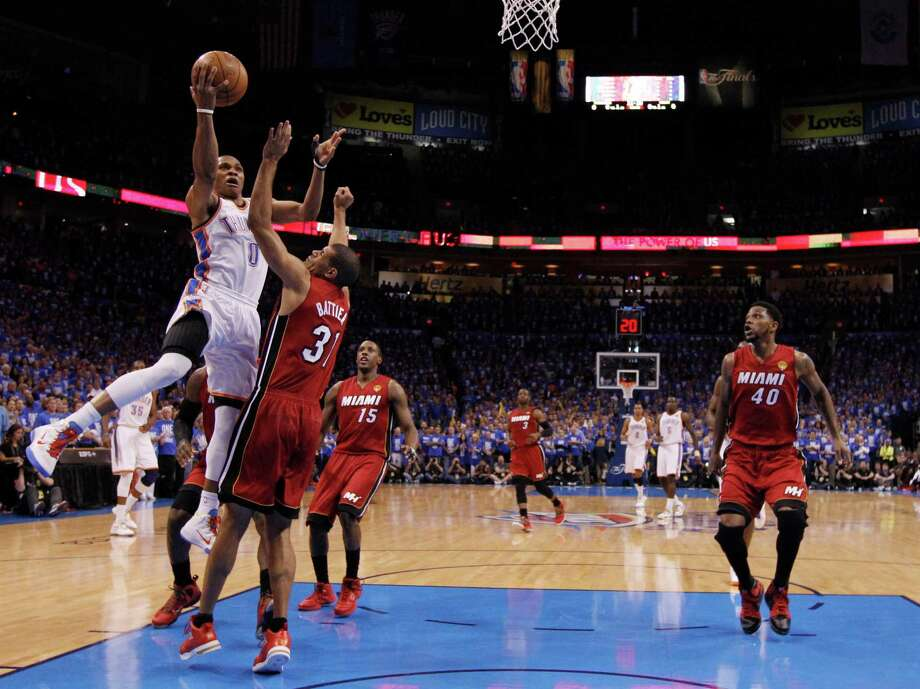 Oklahoma City Thunder point guard Russell Westbrook (0) shoots as Miami Heat small forward Shane Battier defends during the first half at Game 1 of the NBA finals basketball series, Tuesday, June 12, 2012, in Oklahoma City. (AP Photo/Jim Young, Pool) Photo: Jim Young, Associated Press / Reuters Pool