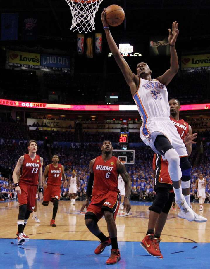 Oklahoma City Thunder small forward Kevin Durant (35) shoots against the Miami Heat during the first half at Game 1 of the NBA finals basketball series, Tuesday, June 12, 2012, in Oklahoma City. (AP Photo/Jim Young, Pool) Photo: Jim Young, Associated Press / Reuters Pool