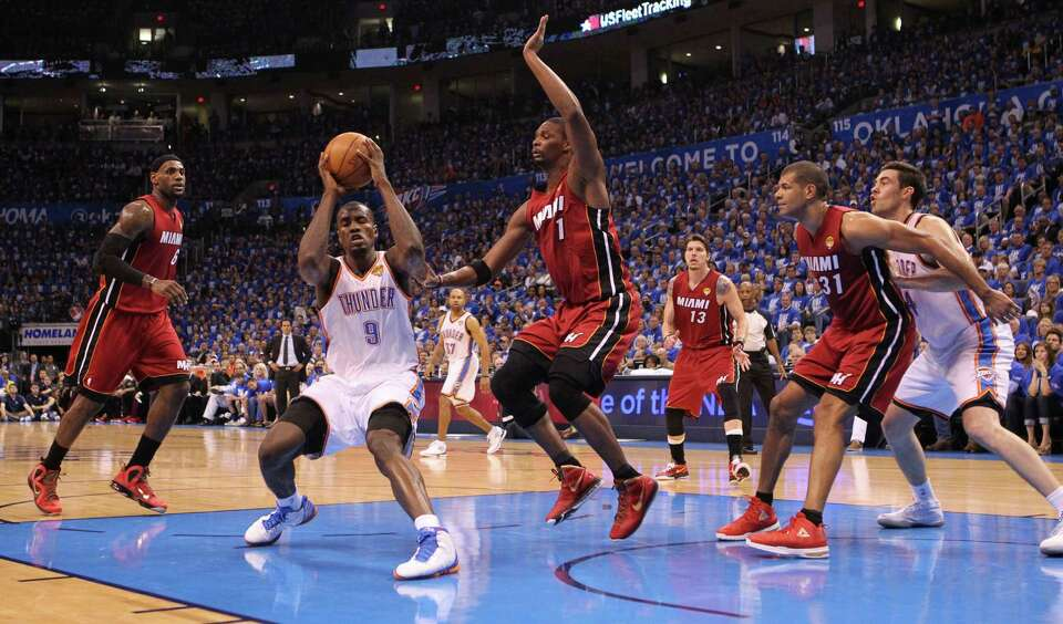The Miami Heat defends against Oklahoma City Thunder's Serge Ibaka in the first quarter during Game