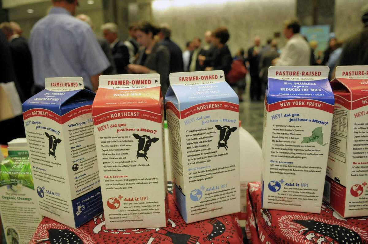 Empty cartons of milk are on display at a table for the Organic Valley Co-Op, a dairy farmer co-op with 1400 members nation wide, at the Assembly Minority Conference?s annual Dairy Day reception in the Legislative Office Building on Tuesday, June 12, 2012 in Albany, NY. The co-op was started 24 years ago and uses the milk produced by their local farmers for milk and cheese products sold in area stores. In the Capital Region the co-op's products can be found in the major super markets and at Honest Weight Food Co-Op. (Paul Buckowski / Times Union)