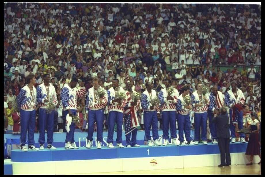 Team USA looks on after winning the gold at the Barcelona Olympics in Barcelona, Spain, 8 Aug 1992.  (Shaun Botterill / Getty Images)