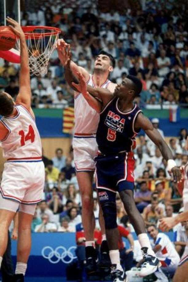 "David Robinson #5 of the United States goes up for a rebound against Stojan Vrankovic #11 and Dino Radja #14 of Croatia during the 1992 Olympic game against Croatia on July 27, 1992 in Barcelona, Spain. The ""Dream Team"" defeated Croatia 103-70.   (Mike Powell / Getty Images)"