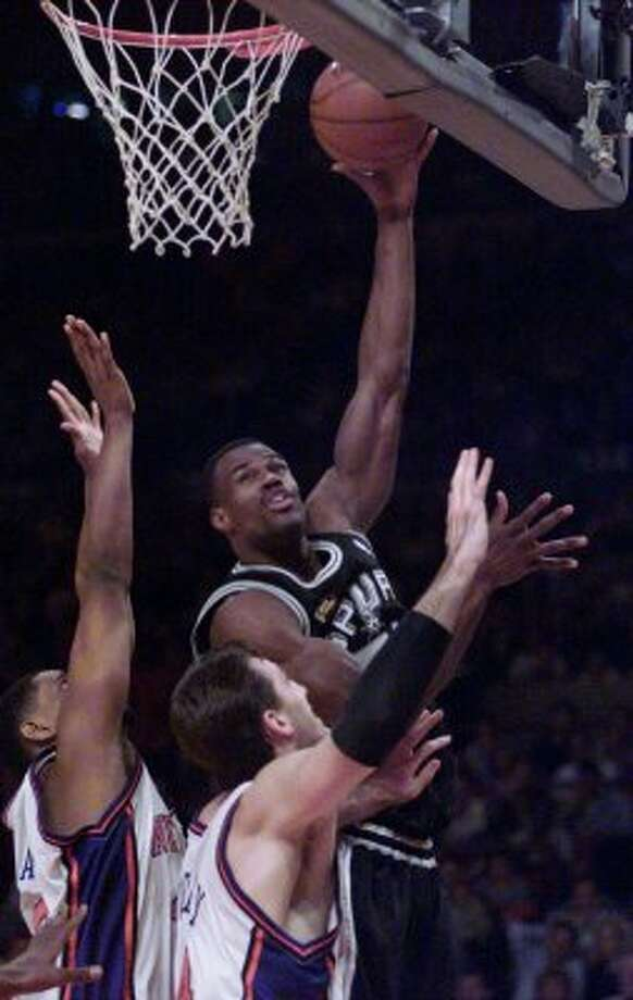 David Robinson shoots his jump hook during Game Five of the NBA Finals Friday June 25, 1999 in Madison Square Garden in New York City.   (JERRY LARA / Express-News)