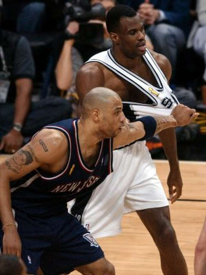 Nets' Kenyon Martin pulls on Spurs' David Robinsons jersey during first half game 6 of the NBA Finals held Sunday June 15, 2003 at the SBC Center in San Antonio,Tx.  (EDWARD A. ORNELAS / SAN ANTONIO EXPRESS-NEWS)