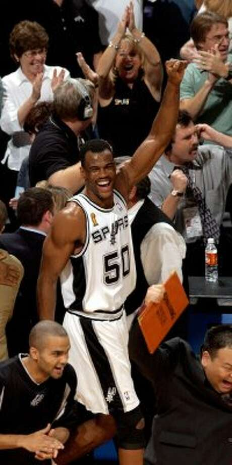 David Robinson and Tony Parker celebrate the Spurs championship game six NBA Finals at the SBC Center in San Antonio Sunday June 15, 2003.  (WILLIAM LUTHER / SAN ANTONIO EXPRESS-NEWS)