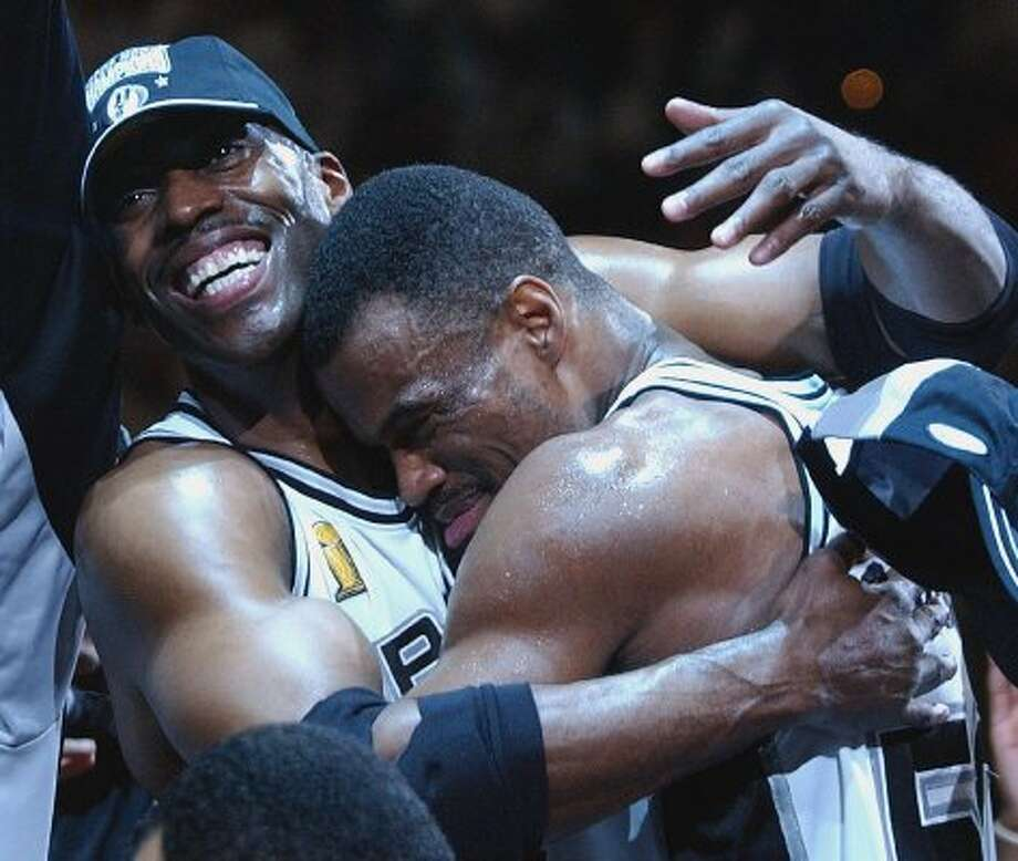 Kevin Willis gives David Robinson a hug during celebrations after winning game six of the NBA Finals at the SBC Center in San Antonio on Sunday, June 15, 2003. (Kin Man Hui/Staff) (SAN ANTONIO EXPRESS-NEWS)